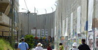 leed pilgrim in Bethlehem alongside the Separation Barrier
